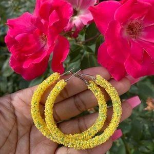 Yellow glitter hoop earrings